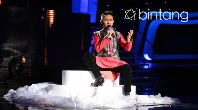 Dalam babak ini, Arin kontestan asal Cirebon harus tersenggol dari D'Academy 3. (Adrian Putra/Bintang.com)