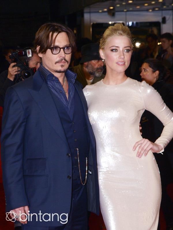 Amber Heard meminta ganti rugi uang sebesar 200 Milyar dan menuntut Johnny Depp pada pihak berwajib. (AFP/Bintang.com)