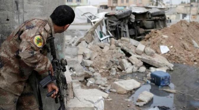 Peperangan di Mosul semakin memanas. Pasukan pemerintah dan koalisi kian menyudutkan ISIS (Reuters).